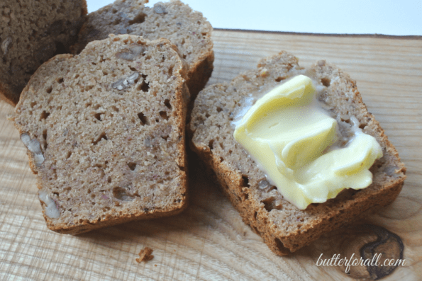 Sliced banana date bread with butter.