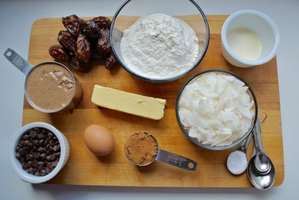 Overhead view of almond cookie ingredients on a cutting board.