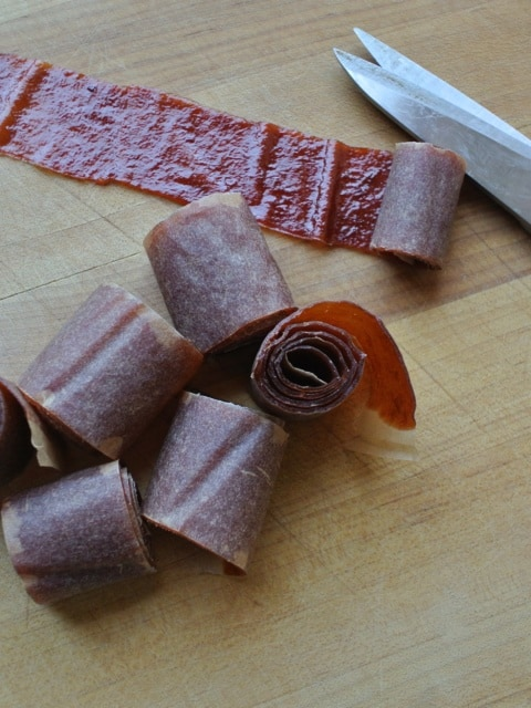 Plum fruit leather cut into spiral pieces.