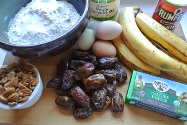 Ingredients to bake banana date bread displayed on a cutting board.