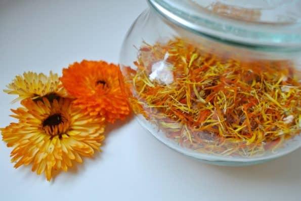 Dried calendula petals in a glass jar.