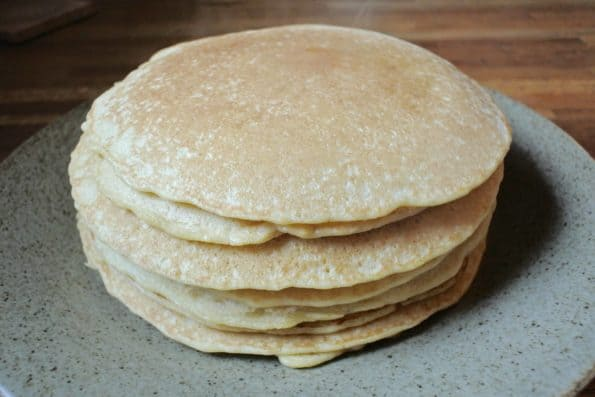 A stack of steamy sourdough pancakes.