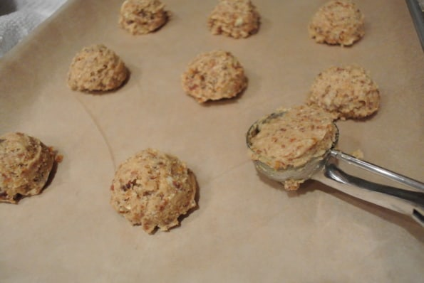 Cookie dough scoops on a baking sheet.