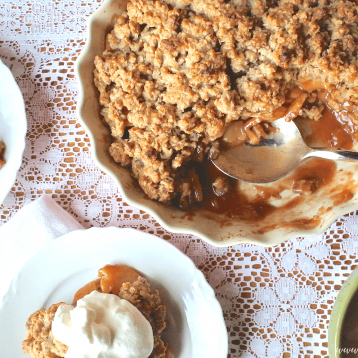 The perfect Apple Crisp with cinnamon spiced cooked apples and a buttery oatmeal cooking topping!