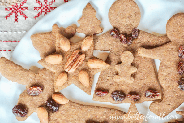 A plate of pretty decorated gingerbread cut-out cookies.