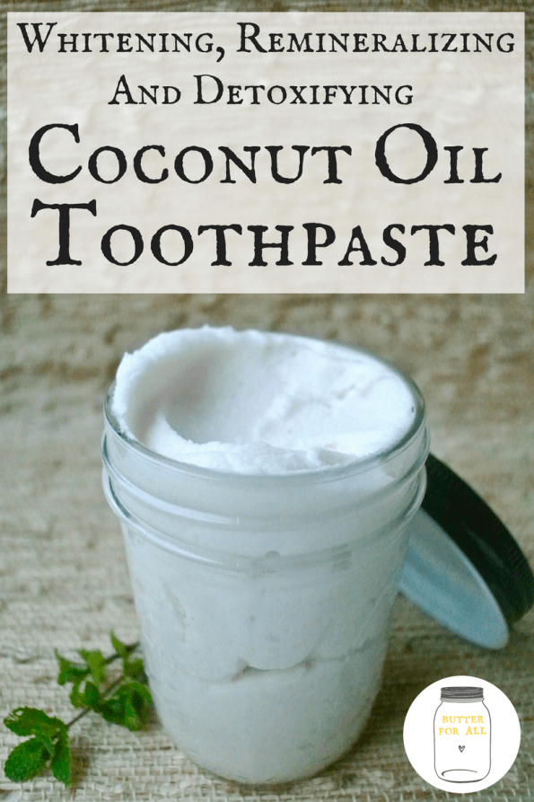 A jar of minty coconut oil toothpaste made with all natural ingredients!