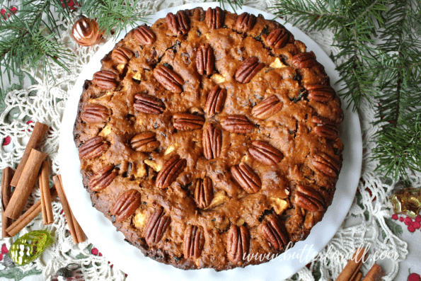 A beautiful big fruit cake studded with nuts and served o Christmas Day.