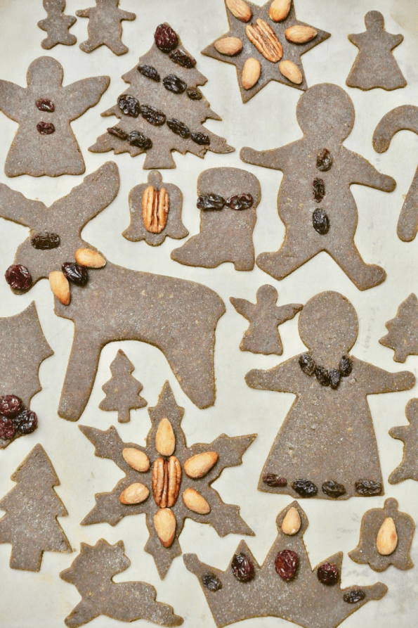 Decorating your gingerbread cut-out cookies with fruit and nuts.