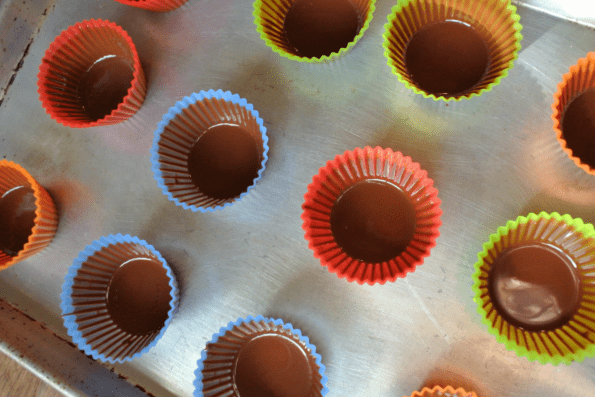 Baking cups with one coat of chocolate.