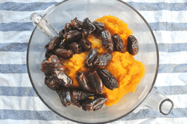 Pureed winter squash and dates in a glass bowl.