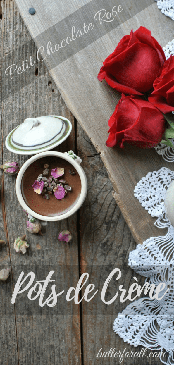 A petit chocolate rose pot de crème on a wooden table with red roses and a text overlay.