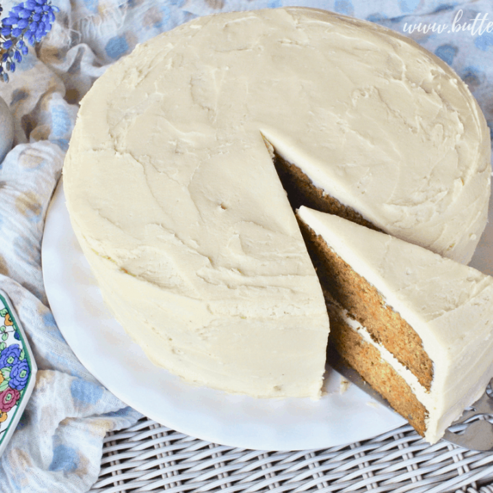 A perfect slice of double decker carrot cake loaded with cream cheese frosting.