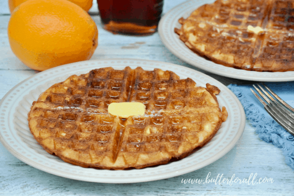 A sourdough waffle with maple syrup and butter.