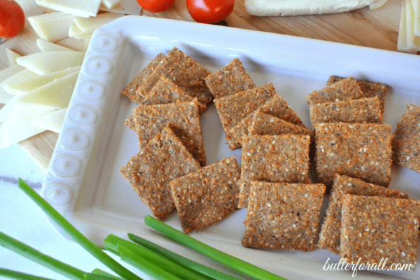 A plate of low-carb sesame, cheese, and nut crackers.
