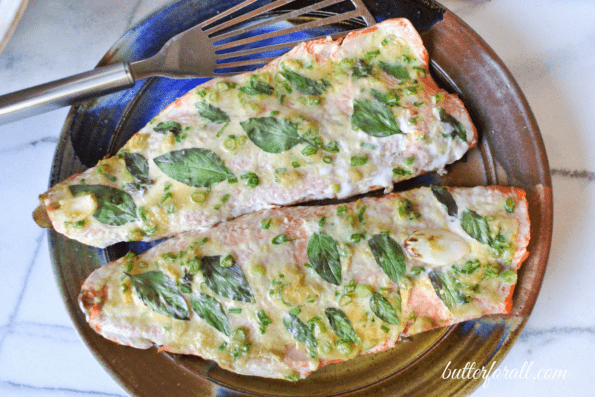 Baked salmon fillets on a plate.