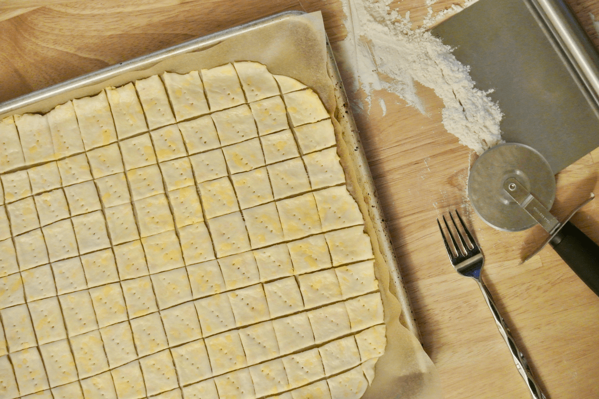 Cutting and docking the dough.