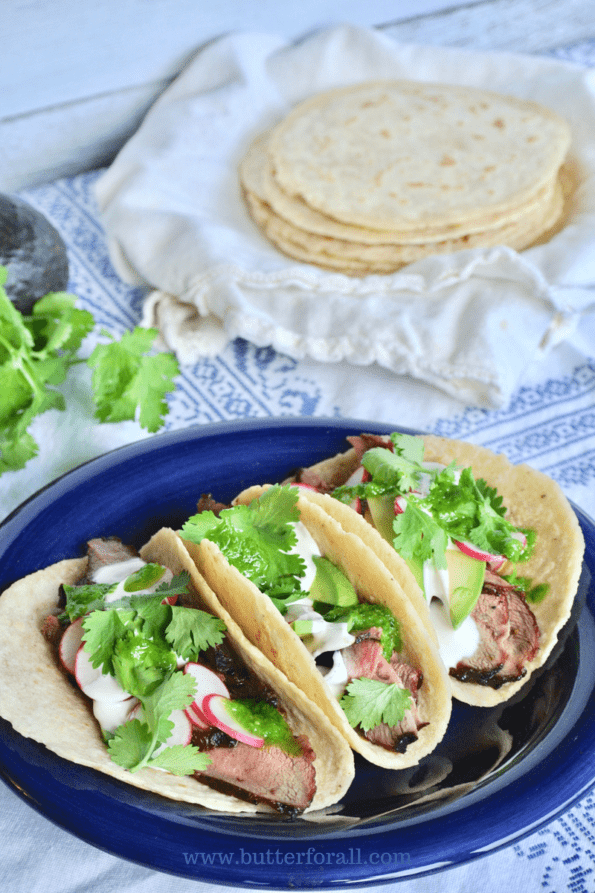 Thick, soft corn tortillas loaded with toppings.