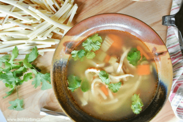 A bowl of grain-free chicken noodle soup with noodles made from bread cheese.