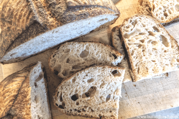 An artisan style sourdough loaf made with whole wheat flour.