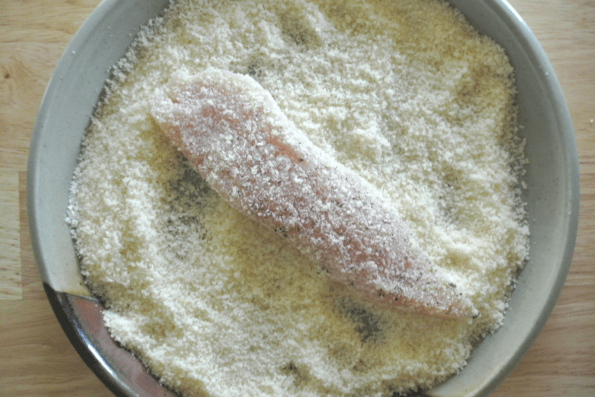 The chicken strip is first rolled in Parmesan cheese.