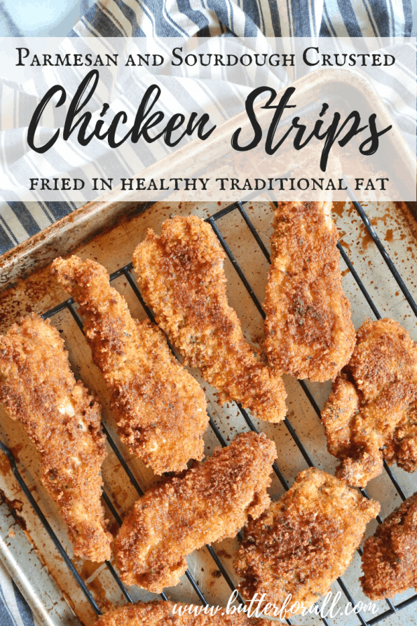 A tray of crispy chicken strips coated in real sourdough bread crumbs and Parmesan cheese with text overlay.