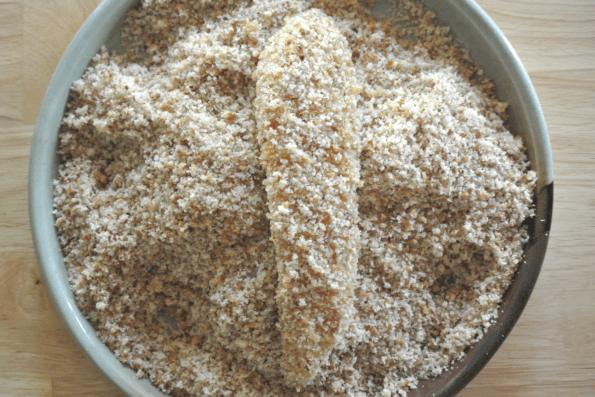 The chicken strips get a final coating of sourdough bread crumbs.