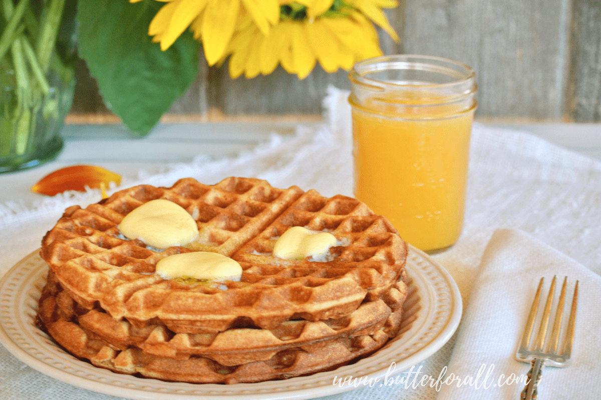 A stacked plate of sourdough and sprouted whole wheat waffles makes a quick, nourished breakfast!