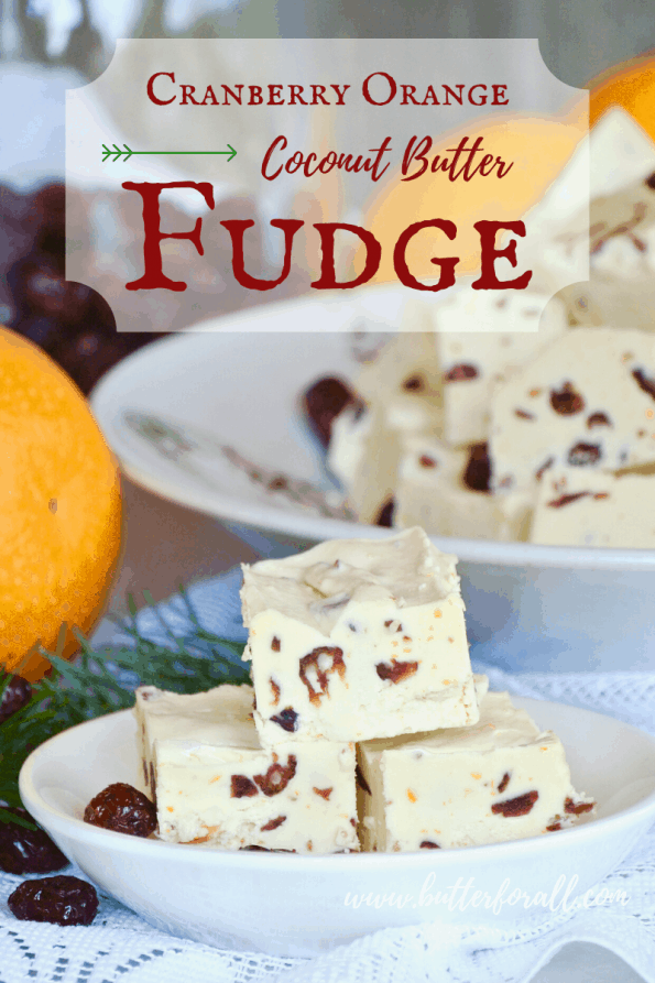 Dishes of honey-sweetened coconut butter fudge studded with dried cranberries and fresh orange zest with text overlay.