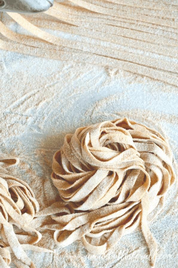 A close-up of uncooked sourdough noodles.