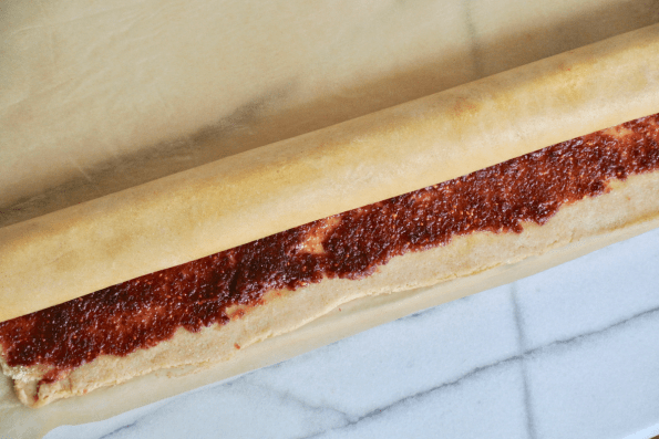 Roll the Sourdough pastry into a tight cylinder from the top down.