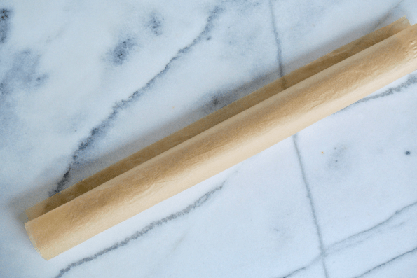 The parchment wrapped cylinder of cranberry filled Sourdough Pastry