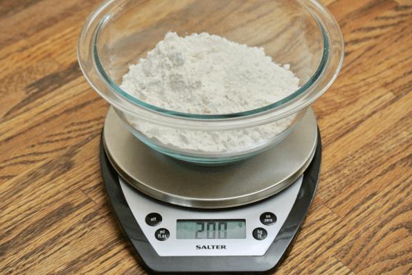 Adding 200 grams of flour to the bowl.