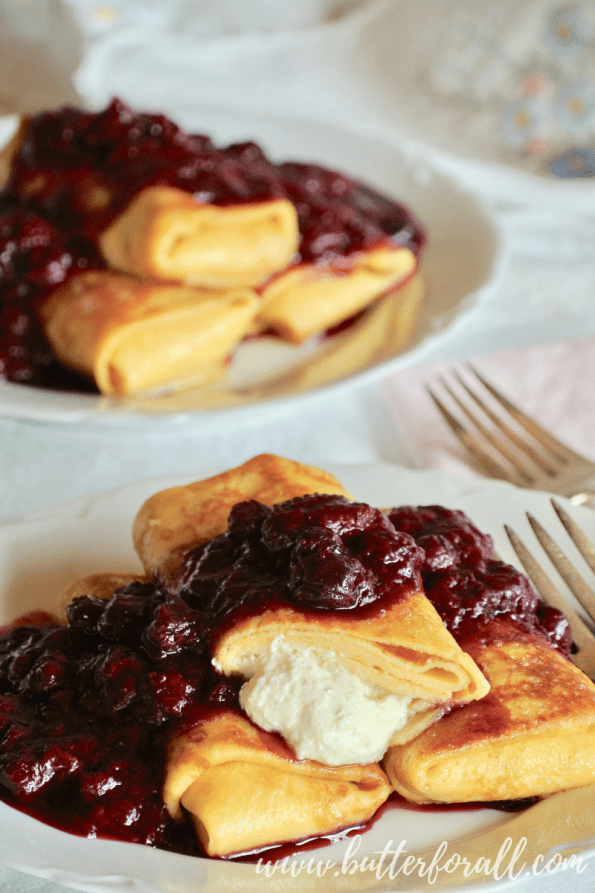 These perfectly butter fried blintzes show the honey sweetened yogurt cheese filling.