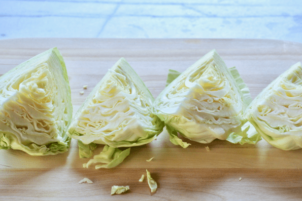 The cabbage is cut into equal quarter.