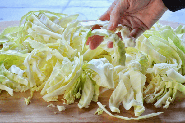 The long strips of cabbage are separated before cooking.
