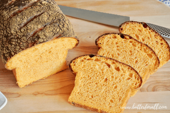 A sliced Sweet Potato Sourdough Loaf with a soft open crumb.
