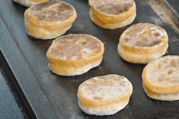 Cooking the English muffins on the second side until done.