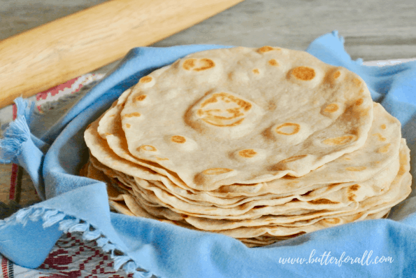 A tall stack of real sourdough tortillas made in the traditional style with pasture raised lard!