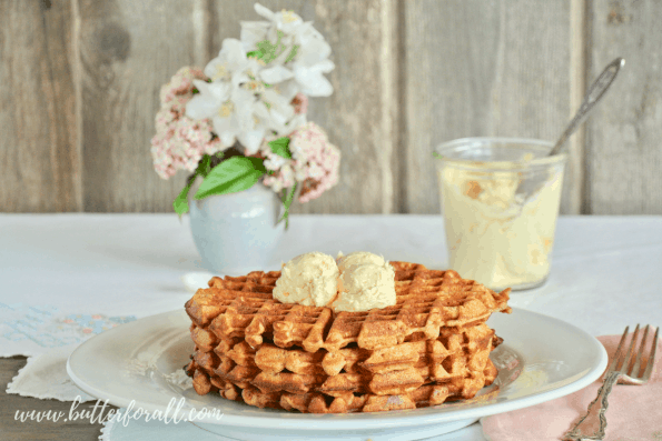 A beautiful brunch table set with Carrot Cake Waffles, Honey Butter Frosting and fresh flowers.