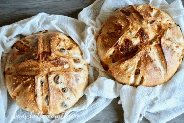 Two cheesy sourdough pizza bread loaves.