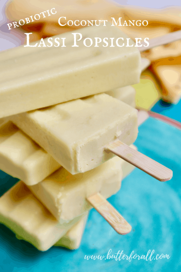 A stack of probiotic coconut mango lassi popsicles with text overlay.