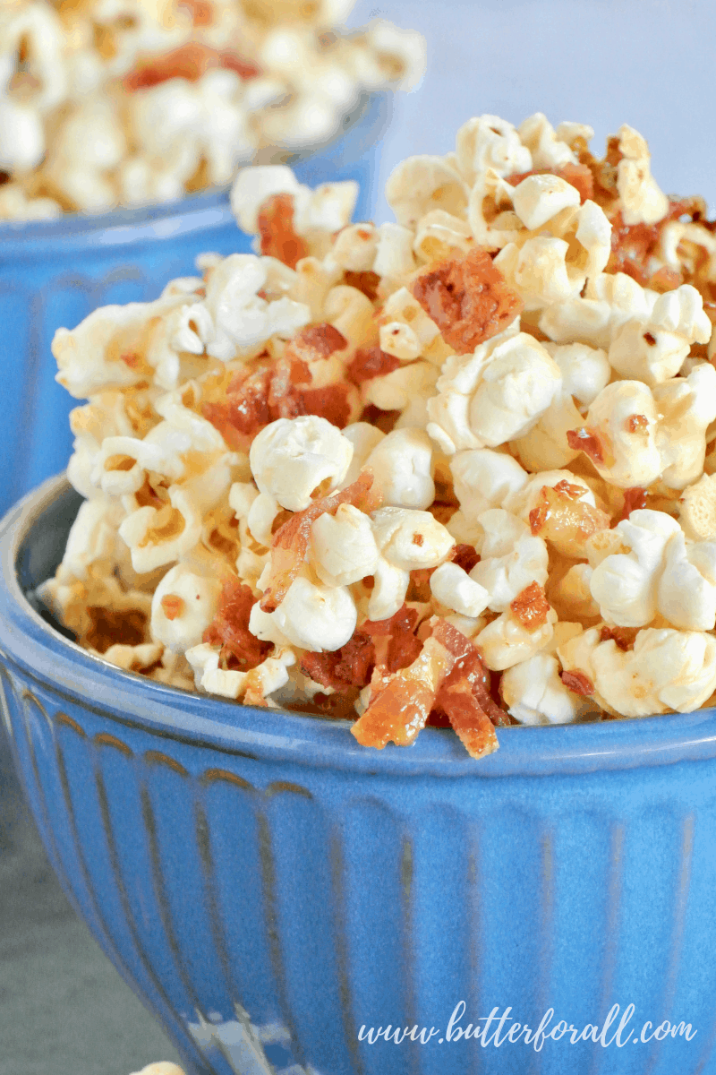 This big bowl of sticky Caramel Corn is made with the classic combination of Maple and Bacon! #realfood #popcorn #coconutoil #bacon #maple #caramel #sweetandsalty #sweetandsavory #baconforlife #healthyfats #moviesnacks