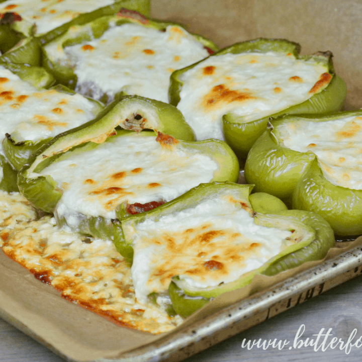 A perfect blend of sweet ricotta and mozzarella cheese melts together in these easy stuffed peppers! #summer #sidedish #bellpeppers #cheese #realfood #sheetpan #lowcarb #keto