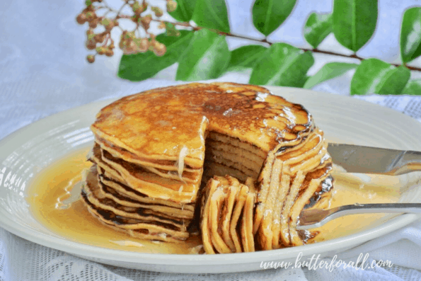 A tall stack for perfectly cooked Sourdough Discard Pancakes with sweet honey syrup!