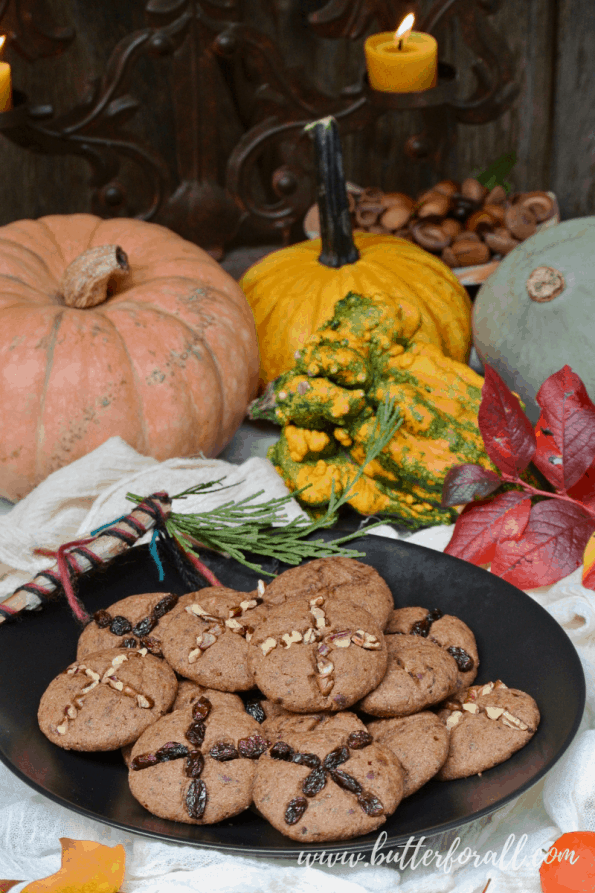 A plate of soft soul cakes with fall table decorations.