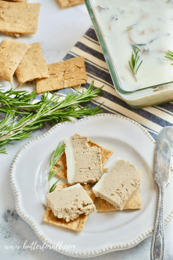 A close-up of beef liver pâté on crackers.