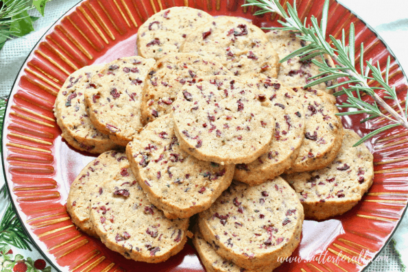 Platter showing a stack of delicious cranberry shortbread cookies.