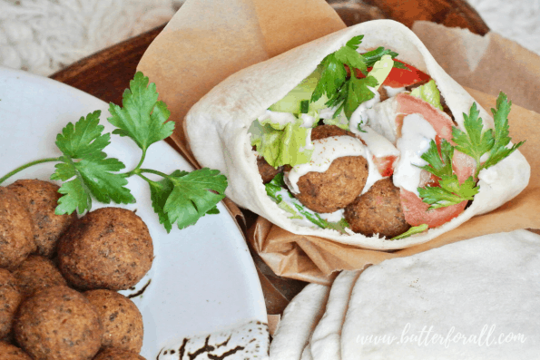 Pita bread overflowing with falafel fillings!
