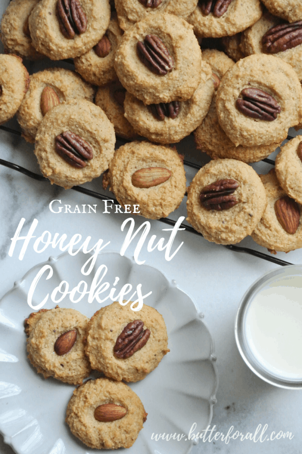 A plate of grain-free cookies topped with pecans with text overlay.