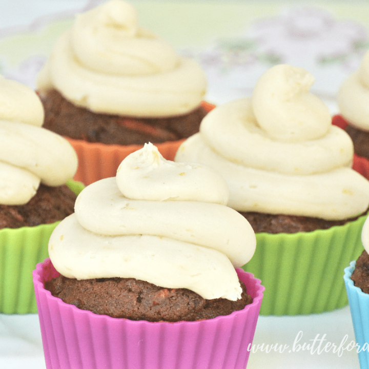 This decadent four ingredient frosting whips up in minutes and is made with real healthy fats and sweetened with real raw honey for a nourishing way to top your favorite treats! #realfood #coconut #butter #frosting #topping #honey #raw #cake #cupcake #vanilla #orange #lemon #healthyfats #norefinedsugar #refinedsugarfree #rawhoney #pasturedbutter #decoration #festive #holiday #food #birthday #party #ideas